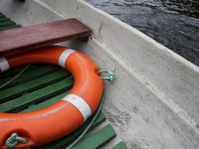 In St. Petersburg under the capsized boat in the water was a man