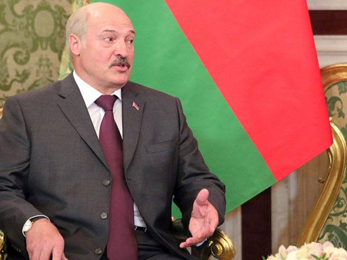 Lukashenko on the background of his